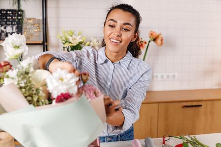 Young florist preparing