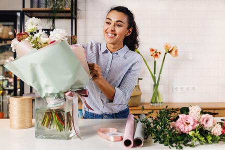 Smiling florist making a bouquet