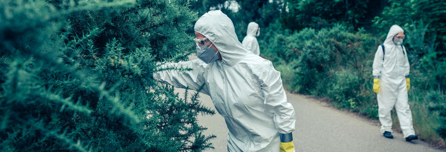 People in bacteriological protection suits looking for samples o