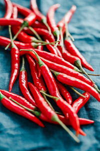 Macro photography of chili peppers on a blue linen
