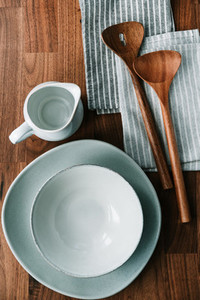 Set of kitchen ceramic tableware on a wooden table  Eco style home still life  top view