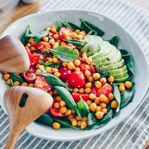 Fresh healthy salad with chickpea avocado cherry tomatoes and spinach