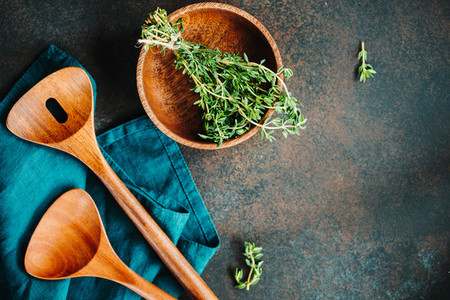 Cooking table background  Wooden kitchen tools and bowl with fresh greens