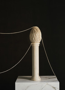 Abstract twine sculpture on small pedestal