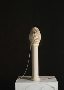 Spool of twine on small pedestal