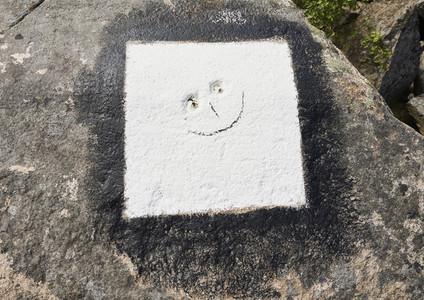 Smiley face in white concrete
