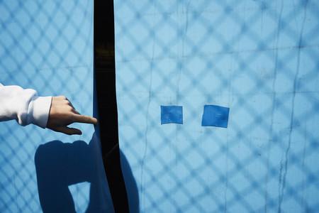 Hand parting blue tarp