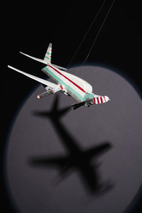 Shadow of model airplane on strings