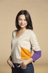 Portrait confident woman in sweater