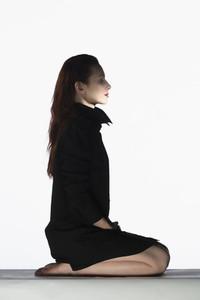 Portrait serene woman in black dress