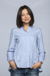 Portrait confident woman in blue and white striped blouse