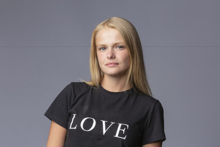 Portrait confident young blonde woman in love t shirt