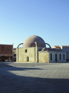 Domed mosque under sunny blue sky