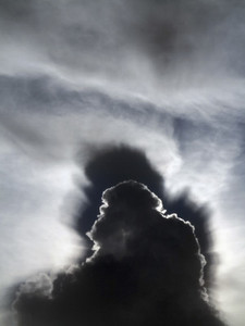 Dramatic storm clouds in sunny sky