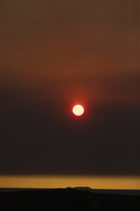 Sun setting in dramatic bush fire sky over York Peninsula