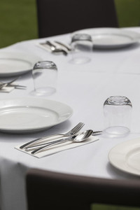Placesettings on round dining table