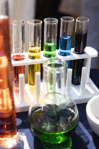 Multicolor liquid in test tube rack and beaker