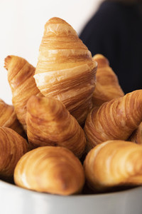Close up fresh croissants in bowl