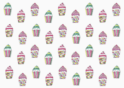 Pastel colored cupcakes on white background