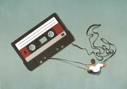 Man pulling tape from large cassette