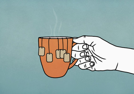 Hand holding mug with many tea bags