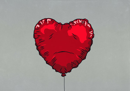 Sad red heart shape balloon