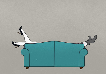 Legs of couple dangling over sofa