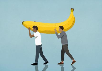 Men carrying large banana