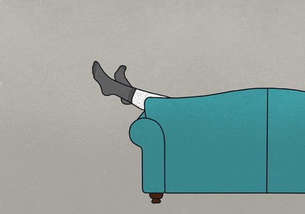 Legs of man in socks dangling off sofa