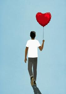 Man walking with heart shape balloon