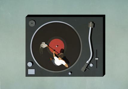 Man scrubbing vinyl record
