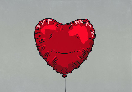 Smiling red heart shape balloon