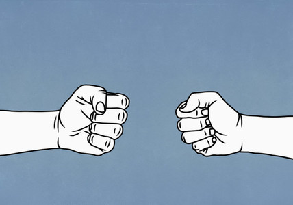 Confrontational hands forming fists