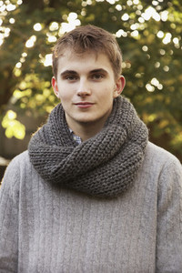 Portrait confident teenage boy with scarf