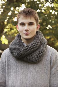 Portrait confident teenage boy with scarf