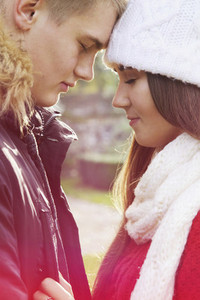 Close up affectionate serene teenage couple head to head