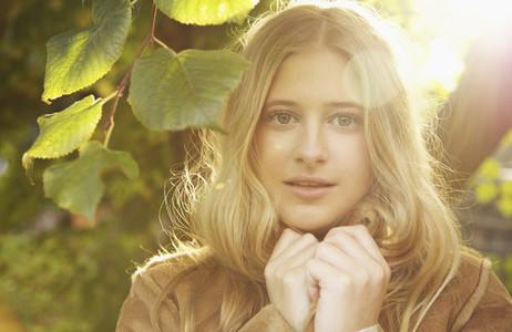 Portrait serene teenage girl in sunny autumn park