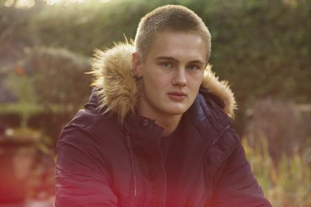 Portrait confident teenage boy in jacket