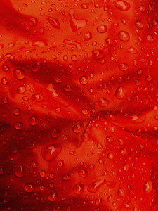 Close up water droplets on red fabric