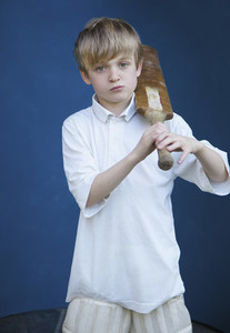 Portrait confident boy with cricket bat