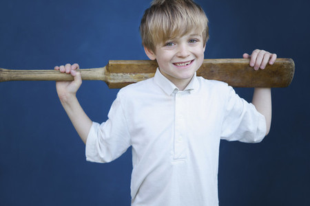 Portrait smiling boy with cricket bat