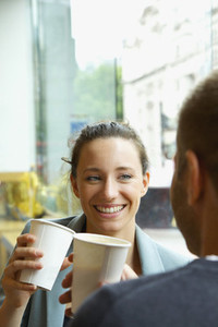 Couple enjoying coffee in cafe window