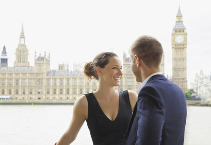 Happy couple standing in front of Thames River and Big Ben