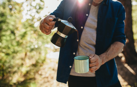 Man having coffee at camping site