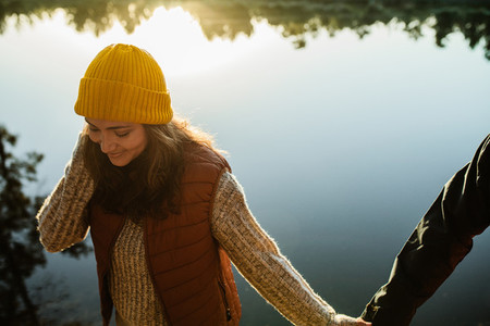 Woman walking by the lake with her man