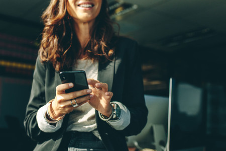 Businesswoman with a on mobile phone in office