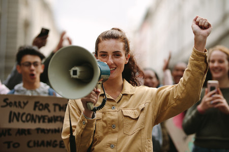 Urban woman protesting at a strike