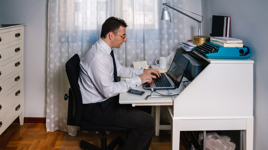 Man teleworking wearing shirt and tie