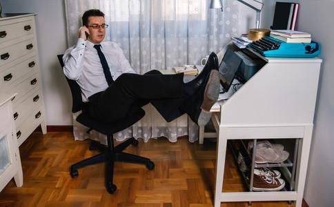 Man teleworking wearing shirt and tie