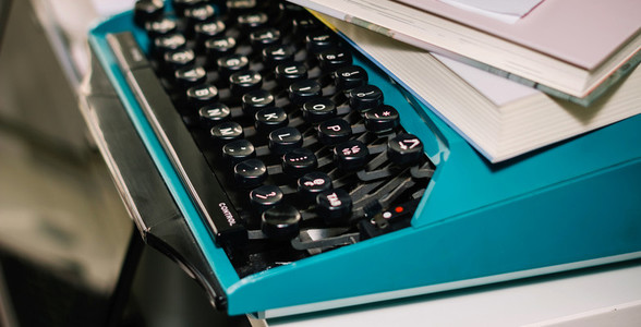 Vintage typewriter in turquoise color